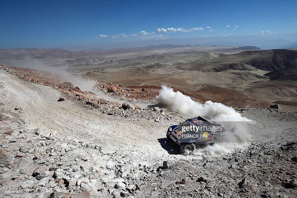 Qatar's Nasser Al-Attiyah competes during Stage 4 of the Dakar 2013 between Nazca and Arequipa, Peru, on January 8, 2013. The rally will take place in Peru, Argentina and Chile from January 5 to 20. AFP PHOTO/Franck Fife