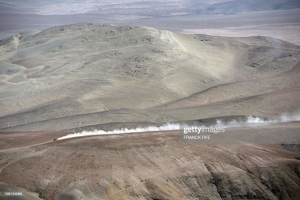 Qatar's Nasser Al-Attiyah competes during Stage 4 of the Dakar 2013 between Nazca and Arequipa, Peru, on January 8, 2013. The rally will take place in Peru, Argentina and Chile from January 5 to 20. AFP PHOTO / FRANCK FIFE