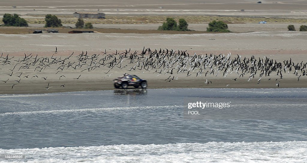 Qatar's Nasser Al-Attiyah competes during Stage 5 of the Dakar Rally 2013 between Arequipa and Arica, Chile, on January 9, 2013. The rally will take place in Peru, Argentina and Chile from January 5 to 20.