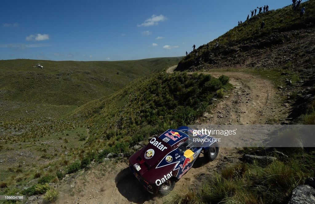 Qatar's Nasser Al-Attiyah competes during the Stage 9 of the Dakar 2013 between Tucuman and Cordoba, Argentina, on January 14, 2013. The rally takes place in Peru, Argentina and Chile between January 5 and 20. AFP PHOTO / FRANCK FIFE