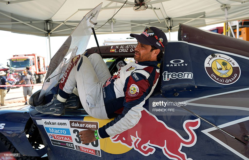 Qatar's Nasser Al-Attiyah gets out of his car after the 5th Stage Arequipa-Arica of the Dakar 2013 race, on January 9, 2013. The rally takes place in Peru, Argentina and Chile from January 5 to 20.