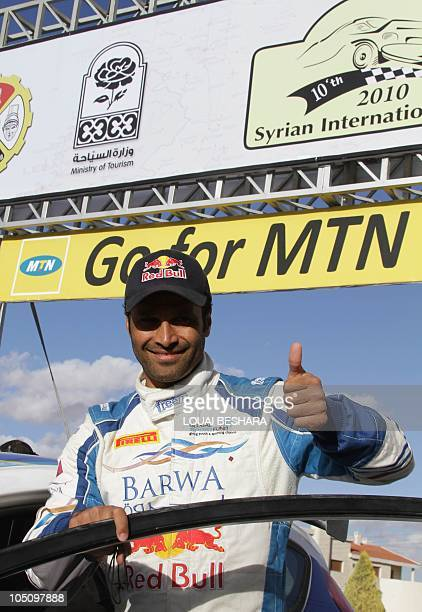 Qatar's Nasser alAttiyah gives the thumbup as he celebrate his win along with codriver Italian Giovanni Bernacchini in the 10th Syrian International...