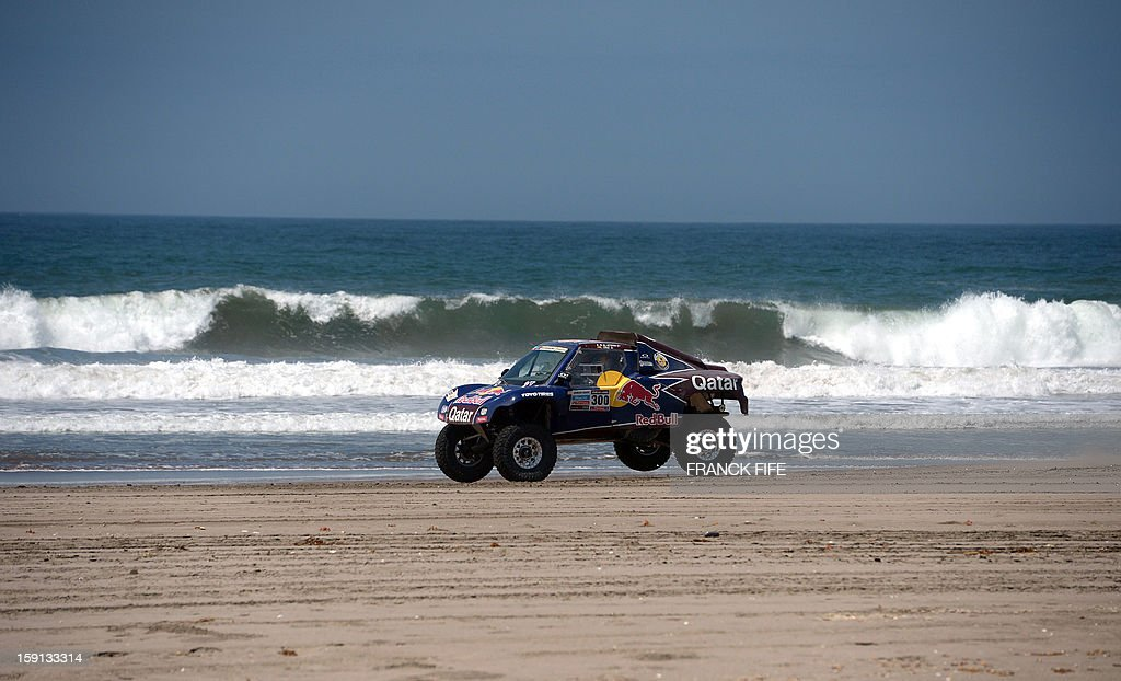 Qatar's Nasser Al-Attiyah jumps with a buggy during Stage 4 of the Dakar 2013 between Nazca and Arequipa, Peru, on January 8, 2013. The rally will take place in Peru, Argentina and Chile from January 5 to 20. AFP PHOTO/Franck Fife
