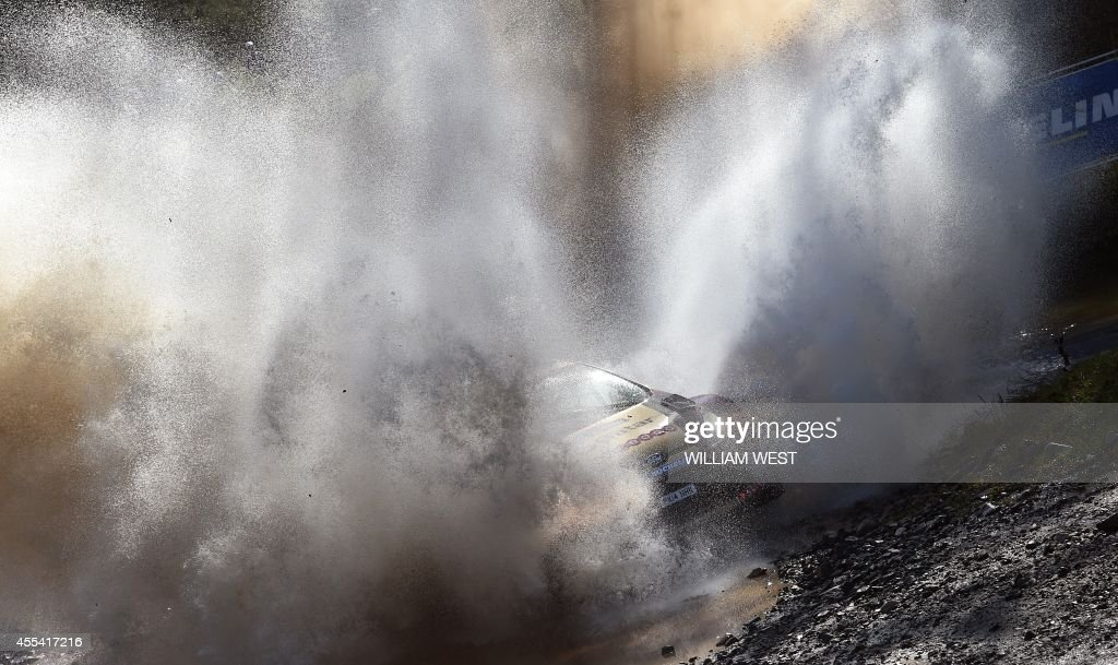 Qatar's Nasser alAttiyah powers through a water crossing in his Ford on the final day of the Rally of Australia near Lowanna on the New South Wales...