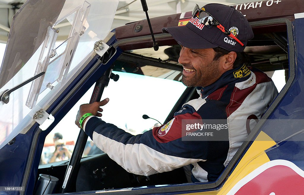 Qatar's Nasser Al-Attiyah smiles at the end of Stage 5 of the Dakar Rally 2013 between Arequipa and Arica, Chile, on January 9, 2013. The rally will take place in Peru, Argentina and Chile from January 5 to 20. AFP PHOTO / FRANCK FIFE