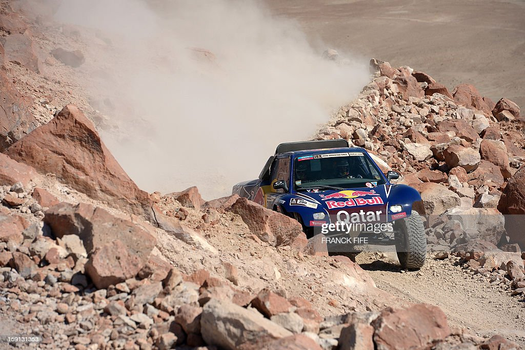 Qatar's Nasser Al-Attiyah steers his Buggy during Stage 4 of the Dakar 2013 between Nazca and Arequipa, Peru, on January 8, 2013. The rally will take place in Peru, Argentina and Chile from January 5 to 20. AFP PHOTO/Franck Fife