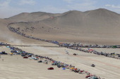 Qatar's Nasser AlAttiyah steers his buggy during Stage 5 of the Dakar Rally 2013 between Arequipa and Arica Chile on January 9 2013 The rally will...