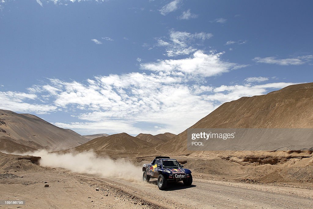 Qatar's Nasser Al-Attiyah steers his buggy during the Stage 5 of the Dakar 2013 between Arequipa and Arica, Chile, on January 9, 2013. The rally will take place in Peru, Argentina and Chile from January 5 to 20.