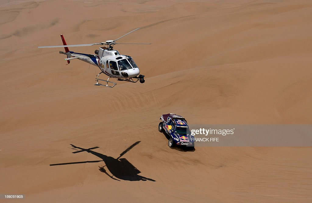 Qatar's Nasser Al-Attiyah steers his buggy during the Stage 6 of the 2013 Dakar Rally between Arica and Calama, Chile, on January 10, 2013. The rally is taking place in Peru, Argentina and Chile from January 5 to 20.