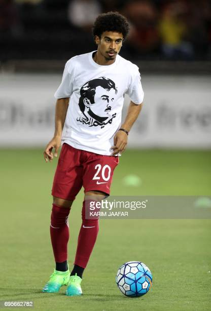 Qatar's national team player Akfram Afif wears a tshirt bearing a portrait of Emir Sheikh Tamim bin Hamad AlThani in support the Qatari leader in the...