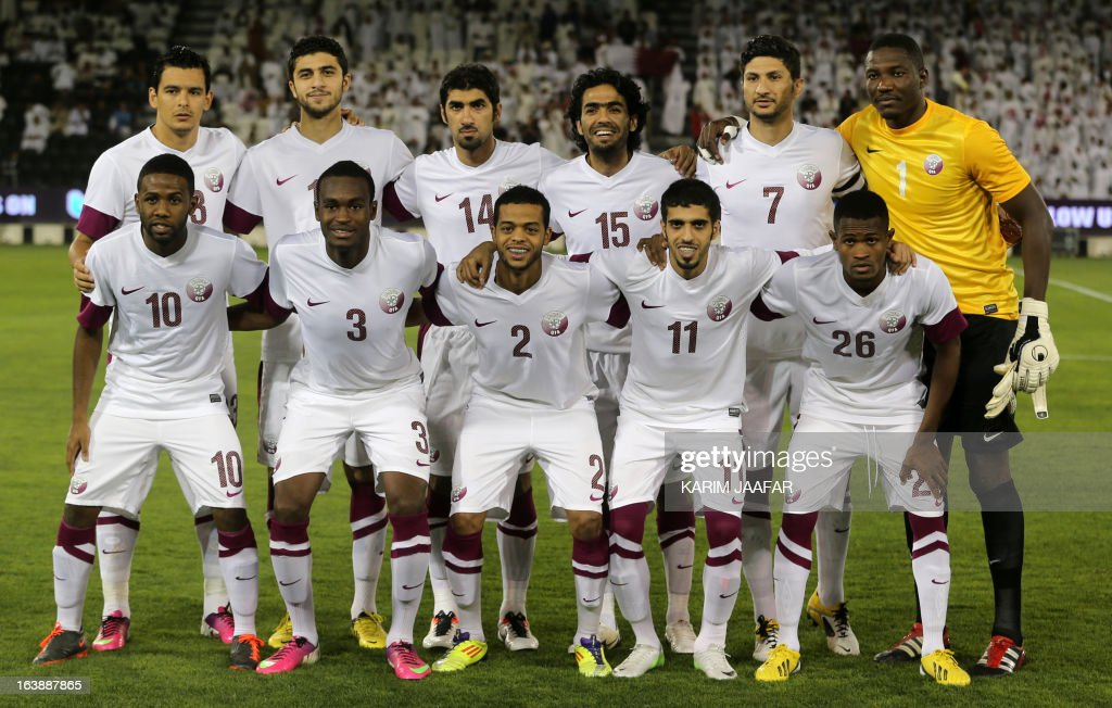 Qatar's national team pose for a picture prior to their friendly football match against Thailand in the capital Doha on March 17, 2013.