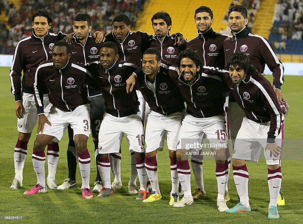 Qatar's national team's players pose before the friendly football Qatar versus Egypt in the Qatari capital Doha on March 7, 2013. The match comes in the frame of the both national teams preparation for Asian and African qualification rounds for FIFA 2014 World Cup Finals in Brazil. AFP PHOTO / AL-WATAN DOHA / KARIM JAAFAR == QATAR OUT ==