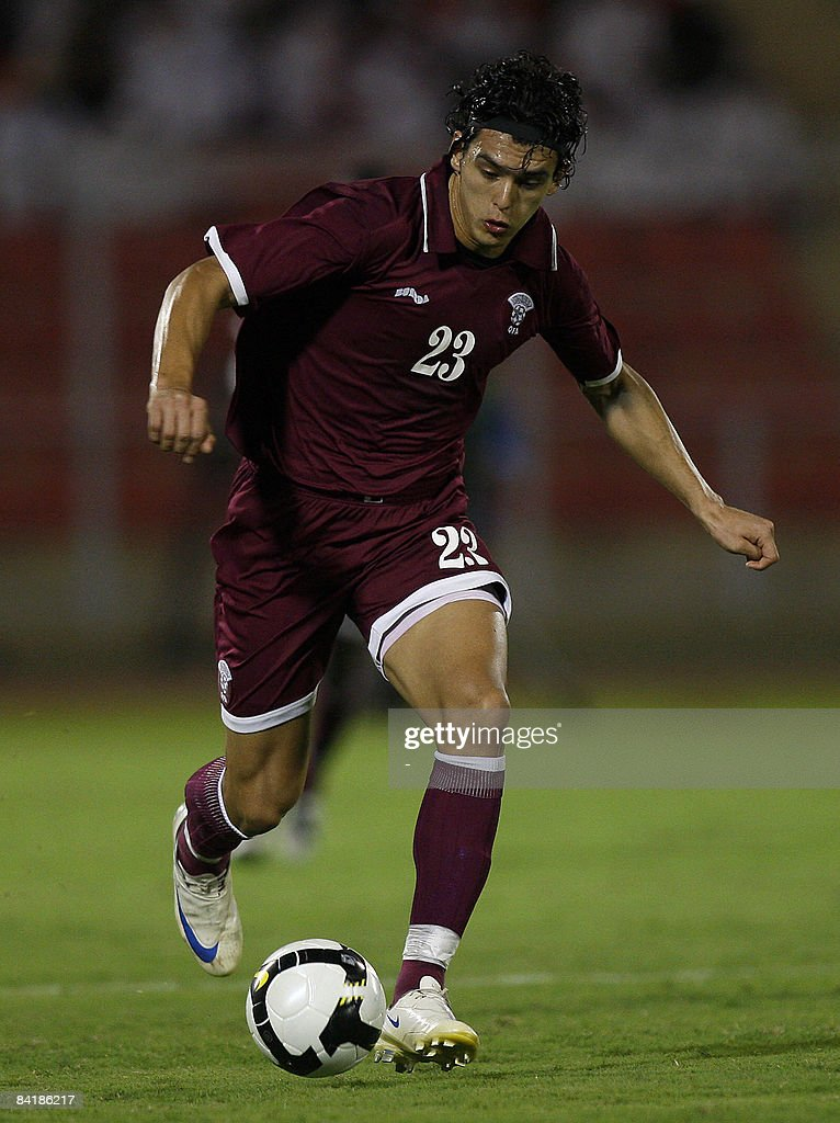 Qatar's player Sebastian Soria runs with the ball during his team's football match against Saudi on the second day of the 19th Gulf Cup in Muscat on...