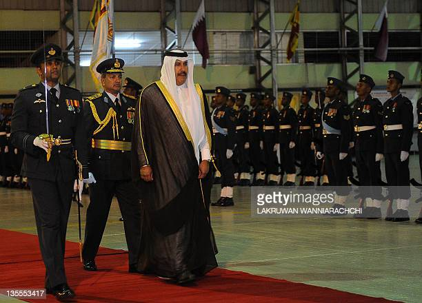 Qatar's Prime Minister and Minister of Foreign Affairs Sheikh Hamad Bin Jissim Bin Jabr Al Thani inspects a guard of honour of Sri Lankan troops...