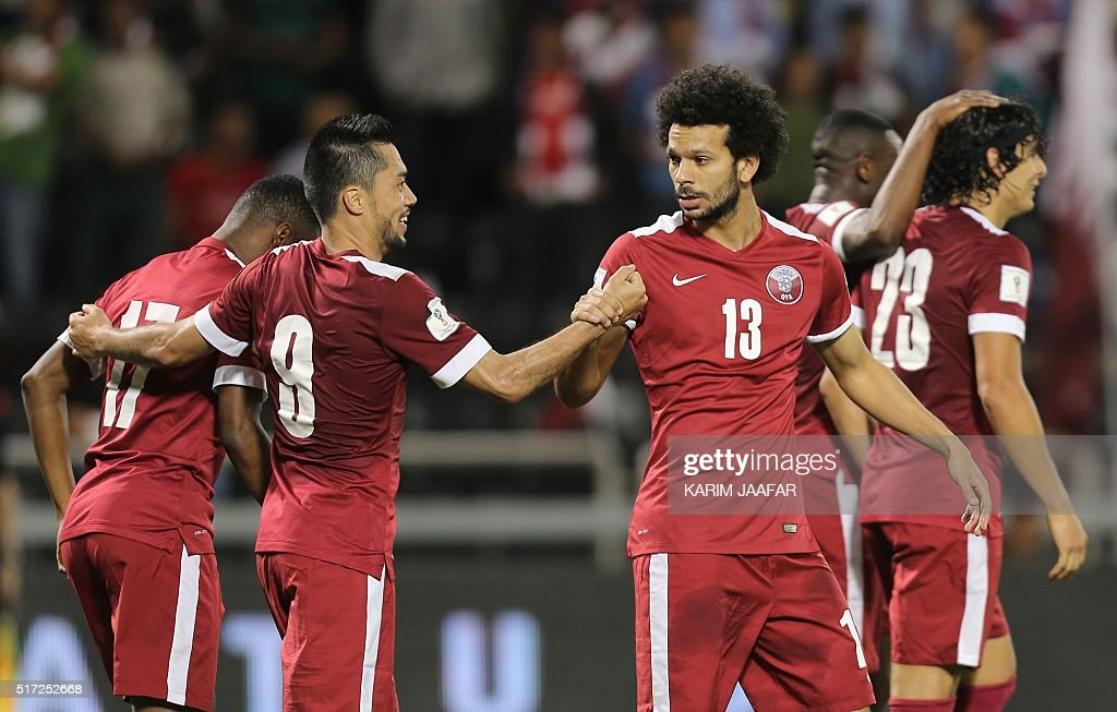 Qatar's Rodrigo Tabata celebrates with Ahmed alSayed after teammate Sebastian Soria scored a goal during the 2018 World Cup football qualifying match...
