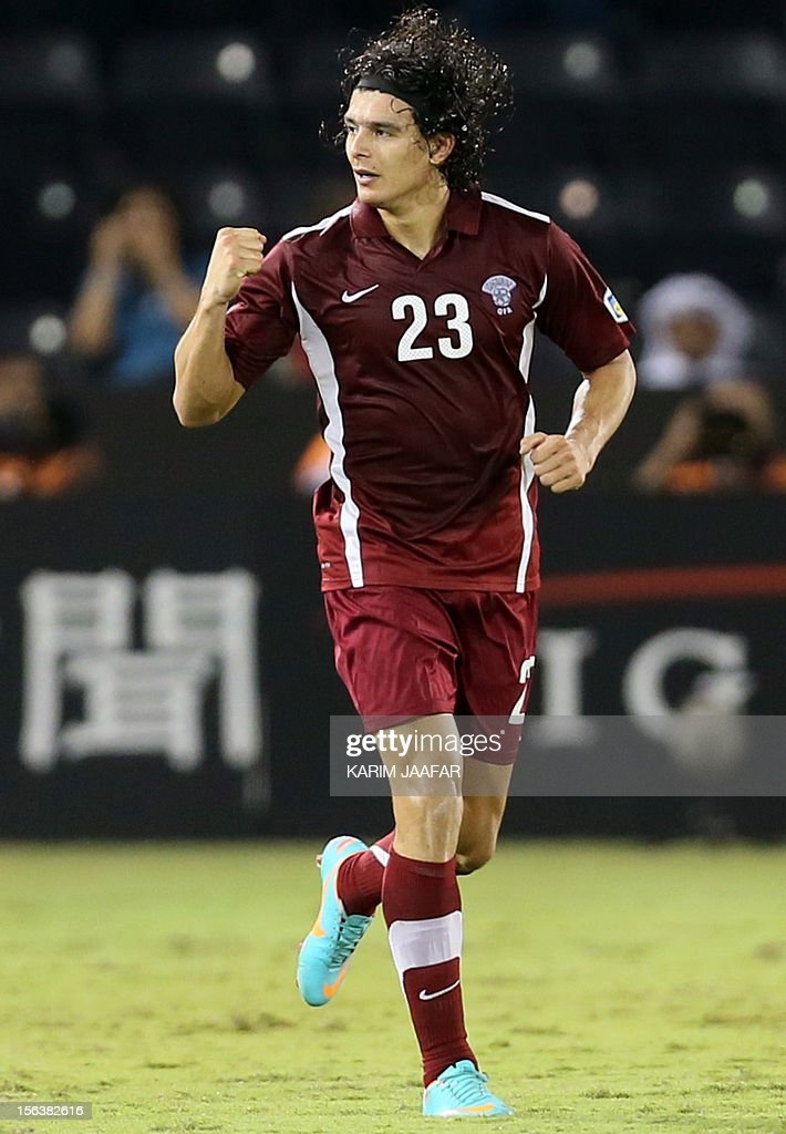 Qatar's Sebastian Soria celebrates after scoring a goal against Lebanon during their 2014 World Cup Asian zone group A qualifying football match in...