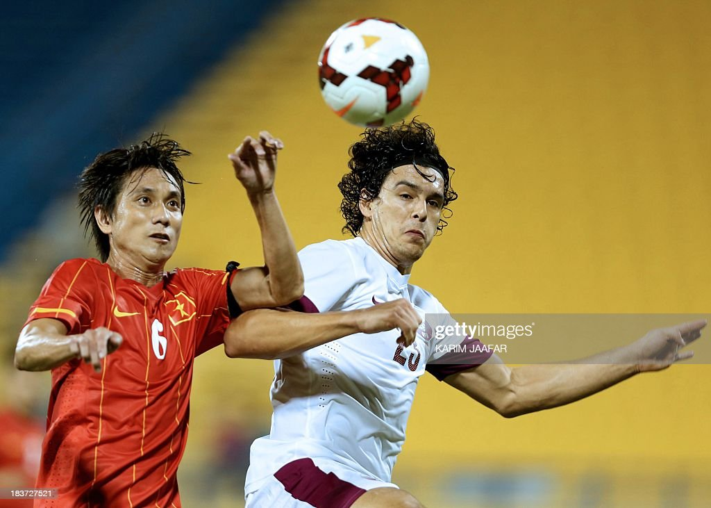 Qatar's Sebastian Soria challenges Chau Le Phuoc Vinh of Vietnam for the ball during their friendly football match at the Jassim Bin Hamad Stadium in...
