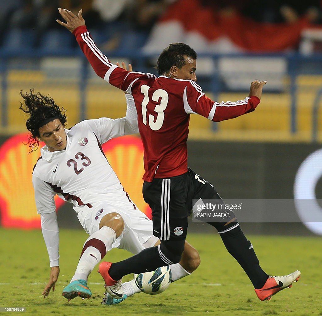 Qatar's Sebastian Soria (L) challenges Egypt's Mohammed Abdel Shafi during their friendly football match in the Qatari capital Doha on December 28, 2012. Egypt won 2-0.