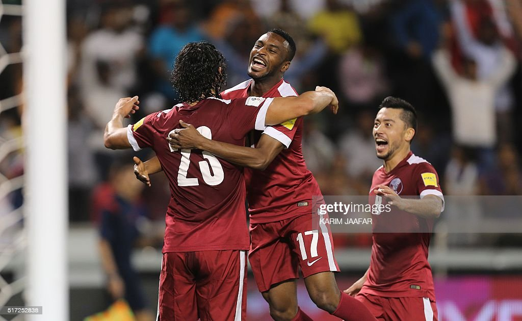 Qatar's Sebastian Soria is congratulated by teammate Ismaeel Mohammad after he scored a goal during the 2018 World Cup football qualifying match...