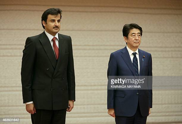 Qatar's Sheikh Tamim bin Hamad alThani stands next to Japanese Prime Minister Shinzo Abe prior to their talks at Abe's official residence in Tokyo on...