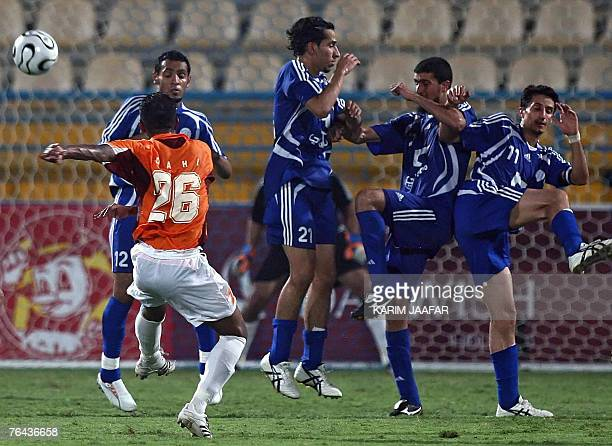 Qatar's Umm Salal club player Dhahi alNubi takes a free kick as players from the Saudi AlHilal club Saad Yusef Sultan alBarqan Fahad alMafrej and...