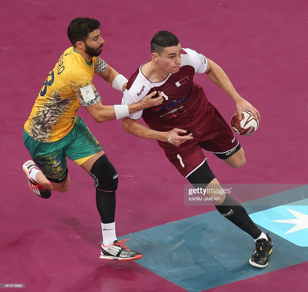 Qatar's Zarko Markovic (R) tries to get past Brazil's <a gi-track='captionPersonalityLinkClicked' href=/galleries/search?phrase=Felipe+Ribeiro&family=editorial&specificpeople=4113764 ng-click='$event.stopPropagation()'>Felipe Ribeiro</a> during the 24th Men's Handball World Championships preliminary round Group A match Qatar vs Brazil at the Lusail Multipurpose Hall in Doha on January 15, 2015. AFP PHOTO / AL-WATAN DOHA / KARIM JAAFAR OUT ==