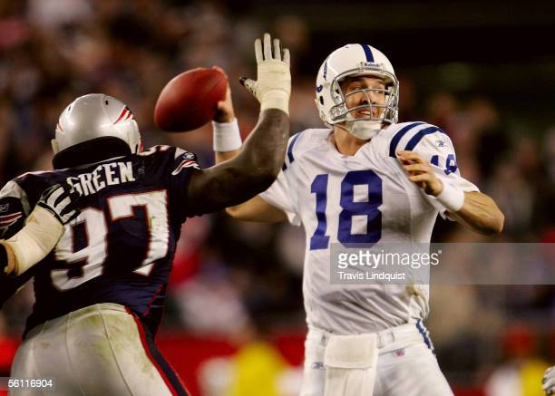 Qaurterback Peyton Manning of the Indianapolis Colts drops back to pass in front of Jarvis Green of the New England Patriots during their game at...