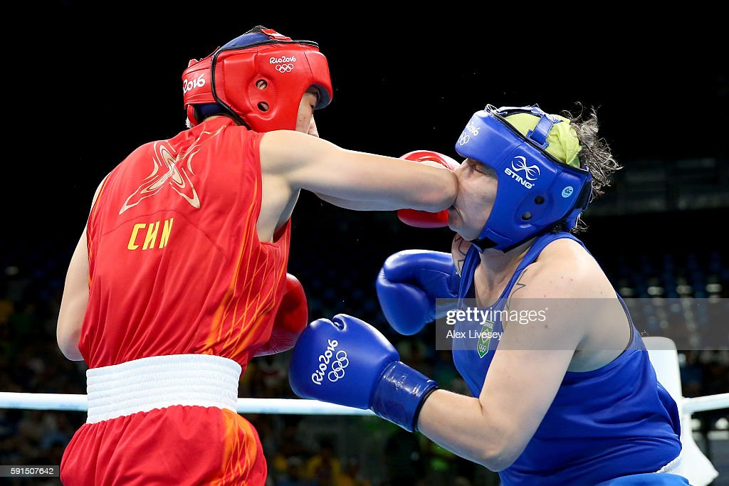Qian Li of China connects with a right to the face of Andreia Bandeira of Brazil during the Women's Middleweight Quarterfinal bout on Day 12 of the Rio 2016 Olympic Games at Riocentro - Pavilion 6 on August 17, 2016 in Rio de Janeiro, Brazil.