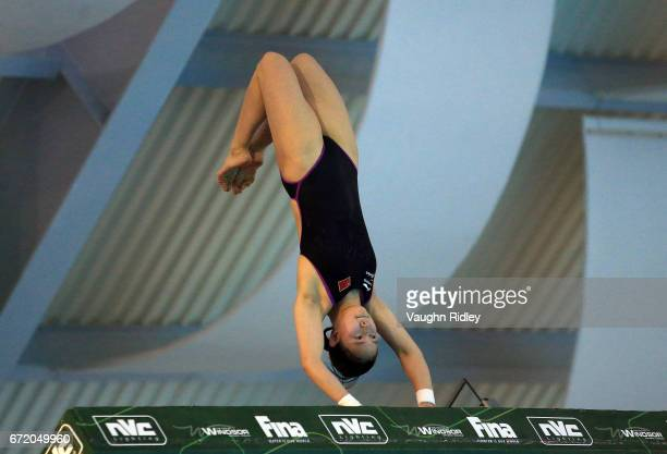 Qian Ren of China competes in the Women's 10m Semifinal B during the 2017 FINA Diving World Series at the Windsor International Aquatic and Training...