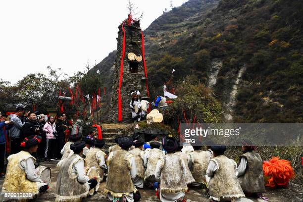 Qiang people holding circumambulation around holy mountain worship activity to celebrate Qiang calendar new year on 20th November 2017 in Wenchuan...