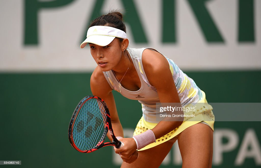Qiang Wang of China awaits a serve during the Ladies Singles second round match against Carla Suarez Navarro of Spain on day five of the 2016 French Open at Roland Garros on May 26, 2016 in Paris, France.