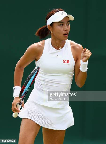 Qiang Wang of China celebrates during the Ladies Singles first round match against KaiChen Chang of Chinese Tapei on day one of the Wimbledon Lawn...