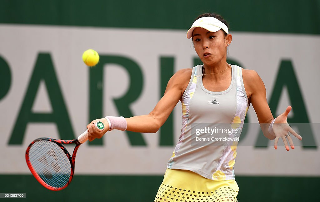 Qiang Wang of China hits a forehand during the Ladies Singles second round match against Carla Suarez Navarro of Spain on day five of the 2016 French Open at Roland Garros on May 26, 2016 in Paris, France.