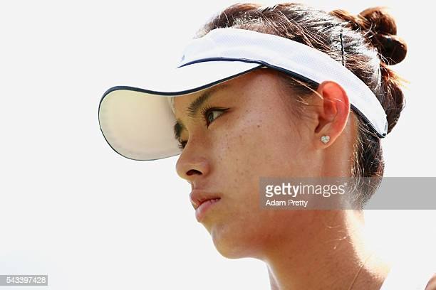 Qiang Wang of China looks on during the Ladies Singles first round match against Daria Gavrilova of Australia on day two of the Wimbledon Lawn Tennis...