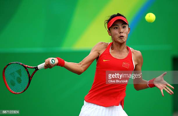 Qiang Wang of China plays a forehand against Swetlana Kuznetsova of Russia in their first round match on Day 2 of the Rio 2016 Olympic Games at the...