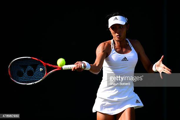 Qiang Wang of China plays a forehand in her Ladies' Singles first round match against Richel Hogenkamp of the Netherlands during day one of the...