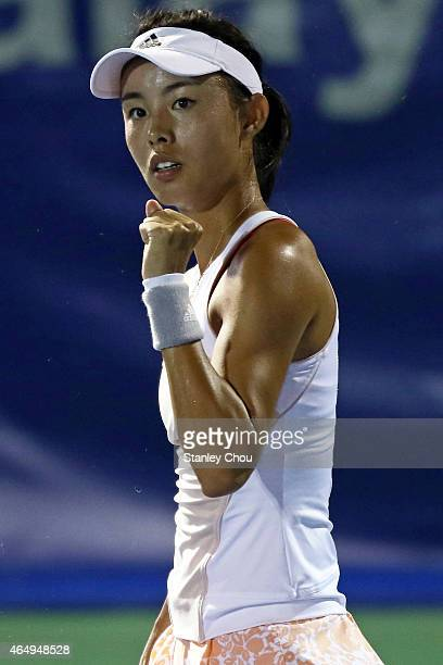 Qiang Wang of China reacts after winning a point against Magda Linette of Poland during day one of the BMW Malaysian Open on March 2 2015 in Kuala...