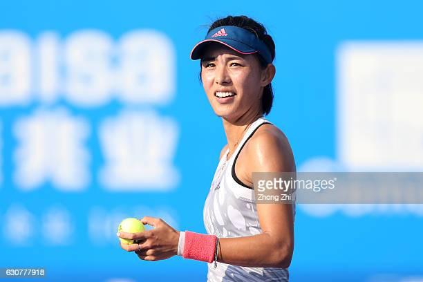 Qiang Wang of China reacts after winning her match against Evgeniya Rodina of Russia during Day 1 of 2017 WTA Shenzhen Open at Longgang International...