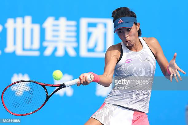Qiang Wang of China returns a shot during the match against Monica Niculescu of Romania during Day 3 of 2017 WTA Shenzhen Open at Longgang...