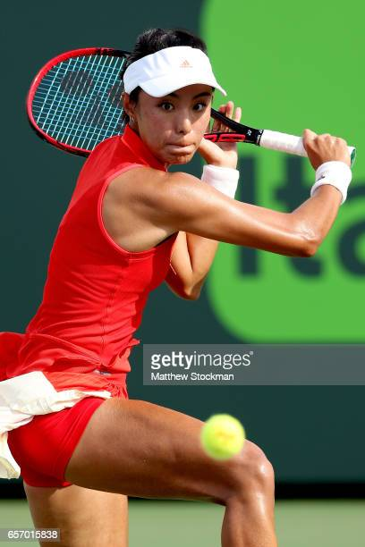 Qiang Wang of China returns a shot to Agnieszka Radwanska of Poland during the Miami Open at the Crandon Park Tennis Center on March 23 2017 in Key...