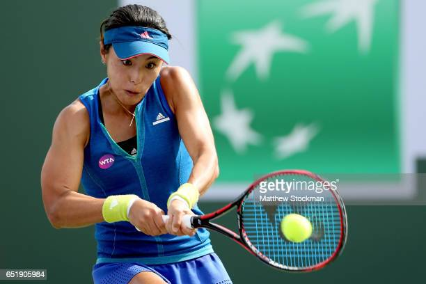Qiang Wang of China returns a shot to Elina Svitolina of Ukraine during the BNP Paribas Open at the Indian Wells Tennis Garden on March 10 2017 in...