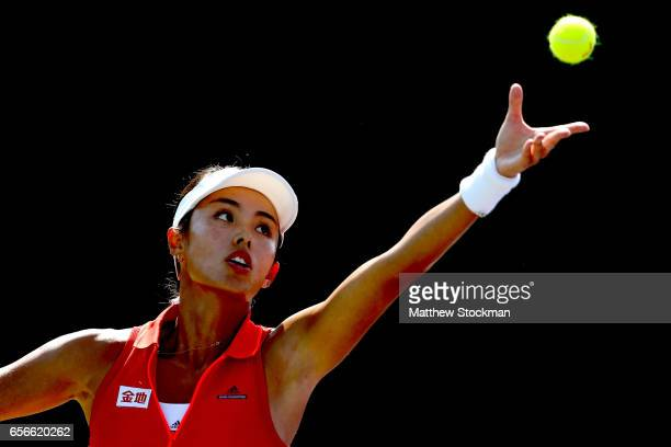 Qiang Wang of China serves to Donna Vekic of Croatia during the Miami Open at the Crandon Park Tennis Center on March 22 2017 in Key Biscayne Florida