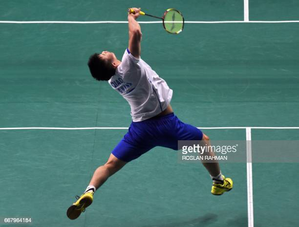Qiao Bin of China hits a return against Sai Praneeth of India during their men's singles round two qualifying match at the Singapore Open badminton...