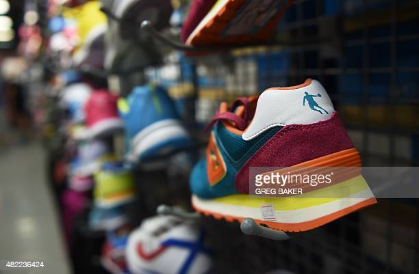 A Qiaodan brand shoe is seen in a store in Beijing on July 29 2015 A Beijing court has dismissed a trademark case brought by US basketball superstar...