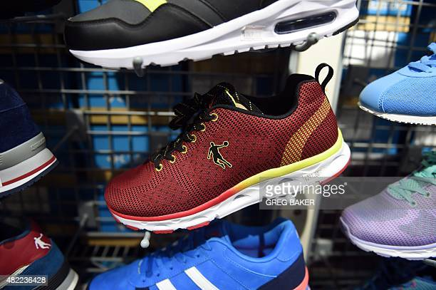 Qiaodan brand shoes are seen in a store in Beijing on July 29 2015 A Beijing court has dismissed a trademark case brought by US basketball superstar...
