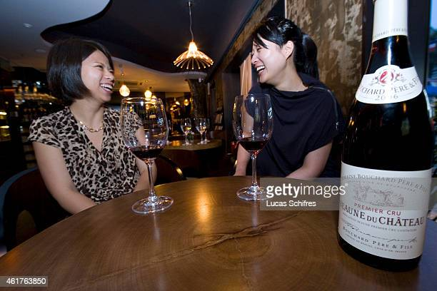 SHENG Qin and CHU Mindy drink French red wine in La LE wine bar on June 19 2010 in Shanghai China