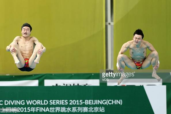 Qin Kai and Cao Yuan of China compete in the men's diving 3 m platform on day one of FINA/NVC Diving World Series 2015 at National Aquatics Center on...