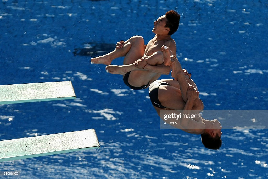 Qin Kai and Feng Wang of China compete in the 3m Mens Synchronised Diving Final at the Stadio del Nuoto on July 18 2009 in Rome Italy