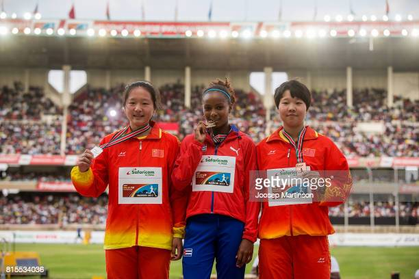 Qing Cai of China Marisleisys Duarthe of Cuba and Qianqian Dai of China pose in the girls javelin throw medal ceremony during day 5 of the IAAF U18...