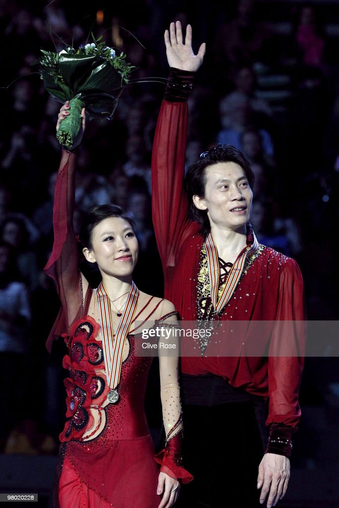 Qing Pang and Jian Tong of China celebrate their Gold medal after winning the Pairs Free Skate during the 2010 ISU World Figure Skating Championships on March 24, 2010 at the Palevela in Turin, Italy.